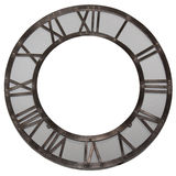 Vintage gray wall clock with roman numbers. Vintage gray metal round wall clock with roman numbers. Vintage gray metal round wall picture frame with roman Stock Photo
