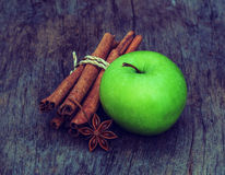 Vintage  green  apple  with star anise and cinnamon sticks on wood Stock Photo