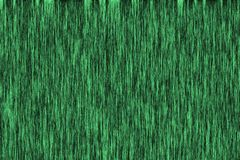 A vintage green background with a grunge screen pattern.  stock photography