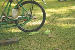 Vintage Green Bike on Grass with Matching Plastic Shoes stock photos