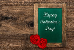 Vintage green blackboard with red roses Royalty Free Stock Photos