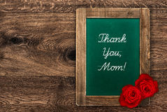 Vintage green blackboard with red roses Stock Photography