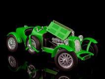 Vintage green car on black Stock Photo