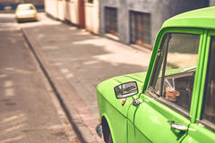 Vintage green car parked on a street Stock Image