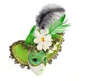 Vintage green carnival mask with hat, flowers and feathers. Isolated on a white background Royalty Free Stock Images