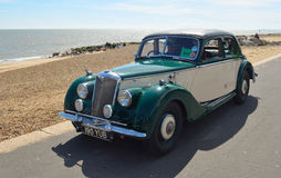Vintage Green and Cream Riley Motor Car. Royalty Free Stock Photos