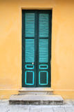 Vintage green door and yellow wall Stock Photo
