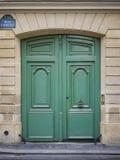 Vintage green doors in Paris, France. Vintage green wooden doors in Paris France Royalty Free Stock Images