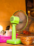 Vintage green electric fan on the table. Vintage green electric fan on white background stock image