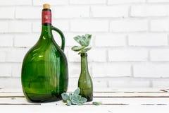 Vintage green glass bottle and desert rose Royalty Free Stock Images