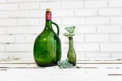 Vintage green glass bottle and desert rose Stock Image