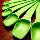 Vintage green measuring spoons. Stock Photos