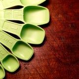 Vintage green measuring spoons. Royalty Free Stock Photos