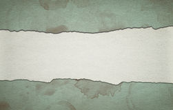 Vintage green paper background with stripe and dirty stains Royalty Free Stock Photos