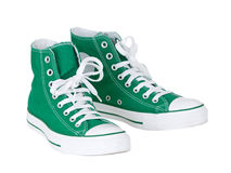 Vintage green shoes. Vintage hanging green shoes on pure white background Royalty Free Stock Photos
