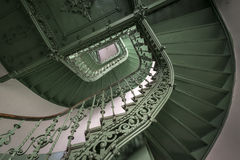 Vintage, green spiral staircase royalty free stock photo