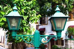 Vintage green street lamp on lamppost Stock Images