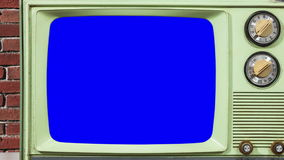 Vintage Green Television and Brick Wall with Zoom into Chroma Key Blue Screen stock video