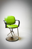 Vintage green vinyl covered barber shop chair. Stock Image