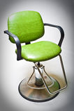 Vintage green vinyl covered barber shop chair.