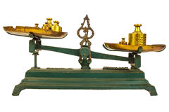 Vintage green weight balance scale isolated on white. With old counterweights on the trays Stock Photos