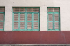 Vintage green window on aged wall Royalty Free Stock Photo