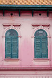 Vintage Green Window on Old Pink wall Stock Photo