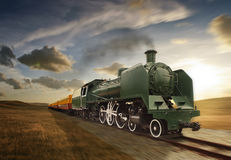 Vintage green and yellow steam powered railway train Stock Images