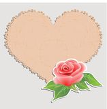 Vintage greeting card. Doily in the form of heart and a rose. Royalty Free Stock Images