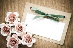 Vintage greeting card and rose flower. Stock Images