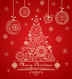 Vintage greeting christmas red card with decorative lacy tree and hanging baubles Stock Photo