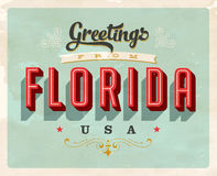 Vintage greetings from Florida Vacation Card. Vintage vector greetings from Florida vacation Card, with a realistic used and worn effect that can be easily Stock Photos