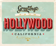 Vintage greetings from Hollywood vacation card. Vintage vector greetings vacation card, with a realistic used and worn effect that can be easily removed for a Stock Photo