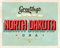 Vintage greetings from North Dakota Vacation Card. Vintage vector greetings vacation Card, with a realistic used and worn effect that can be easily removed for a Stock Image