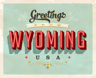 Vintage greetings from Wyoming Vacation Card. Vintage vector greetings vacation Card, with a realistic used and worn effect that can be easily removed for a Stock Photo
