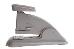 Vintage grey stapler, side view. Side view of an old vintage grey stapler Royalty Free Stock Images