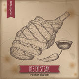 Vintage grilled rib eye steak template placed on old paper background. Stock Photos