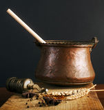 Vintage grinder and cauldron with spices Royalty Free Stock Photography