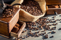 Vintage grinders and coffee beans Stock Images