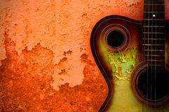 Vintage grunge background with guitar. On wall Stock Image