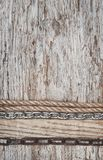 Vintage grunge background with rope and chain on wood texture. Vintage grunge background with rope and chain on old wood texture Royalty Free Stock Photos