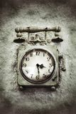 Vintage Grunge Clock on Stone Wall Stock Photos