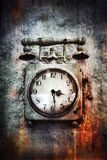 Vintage Grunge Clock on Stone Wall Royalty Free Stock Photo