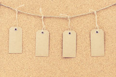 Vintage grunge empty tags hanging on rope string Royalty Free Stock Photo