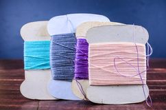 Vintage grunge four peper thread spool on wooden board Stock Photos