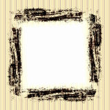 Vintage Grunge Frame. In brown with white copyspace on a striped yellow, tan, and brown wallpaper background Stock Photo