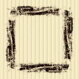 Vintage Grunge Frame. In brown strokes with  on a striped yellow beige wallpaper background Royalty Free Stock Photo