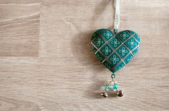 Vintage grunge heart hanging over wood background Stock Photos