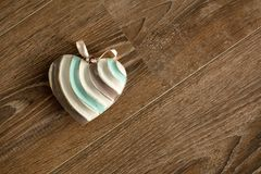 Vintage grunge heart lying over wood background Royalty Free Stock Images