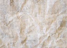 Vintage grunge newspaper paper texture background. Blurred old crumpled newspapers backdrop. A blur unreadable aged news page with place for text. Gray brown royalty free stock photo